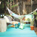 pastel blue recycled plastic outdoor rugs white backyard outdoor hammock white chairs white pastel cushions glasses accent cactus pots gardening plants