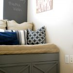 pillows cabinet picture wall black board rug