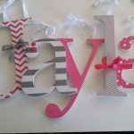 playful jayla large decorative letters design with chevron pattern and stripe accent in gray and pink color on white wall