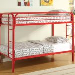 red metal bunk bed for small space design with white bedding aside potted plants on wooden floor with glass window