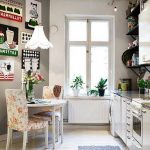 retro style appliance idea with white cabinetry and wall racks and patterned floral chairs idea with runner rug