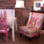 retro style lilly pulitzer furniture idea with clorful pink tall backrested chair and white table with pink chairs on wooden floor with white shaded floor lamp and wooden console