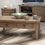 rustic high end coffee tables made of solid wood with double drawer underneath with some ceramic on its top for centerpiece and completed with rug under the table