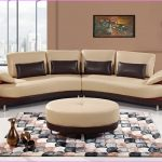 semi circular sofa in lighter cream deep brown throw pillows round ottoman furniture cool modern rug with multiple colors
