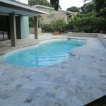 silver tumbled travertine pavers pool deck backyard patio cover small blue swimming pool green gardening plant