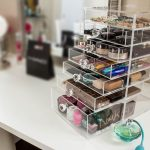 simple adorable makeup organizing idea with some drawers in small storage on white table