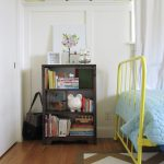 simple and small wooden shabby chic bookshelves idea beneath white wall with chevron patterned area rug