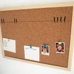 simple cool cork boards in brown with frame decorated with memos and photographs