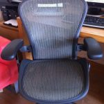 simple navy blue aeron chair design with adjustment and legs with wheels and armrests and backrest