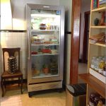 simple single glass front refrigerator for home design aside wooden chair and spice storage