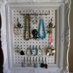 simple small white framed pegboard jewelry display beautiful color stone necklaces bracelets earrings