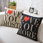 simple wedding gifts cute cushions or pillows for sofa with love you most and love you more font in black and brown colors