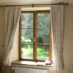 simple white stripe shades for natural wooden casement windows with ivory walls and natural wooden side table