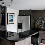 sleek absolute black granite countertop for modern elegant kitchen with black cabinets