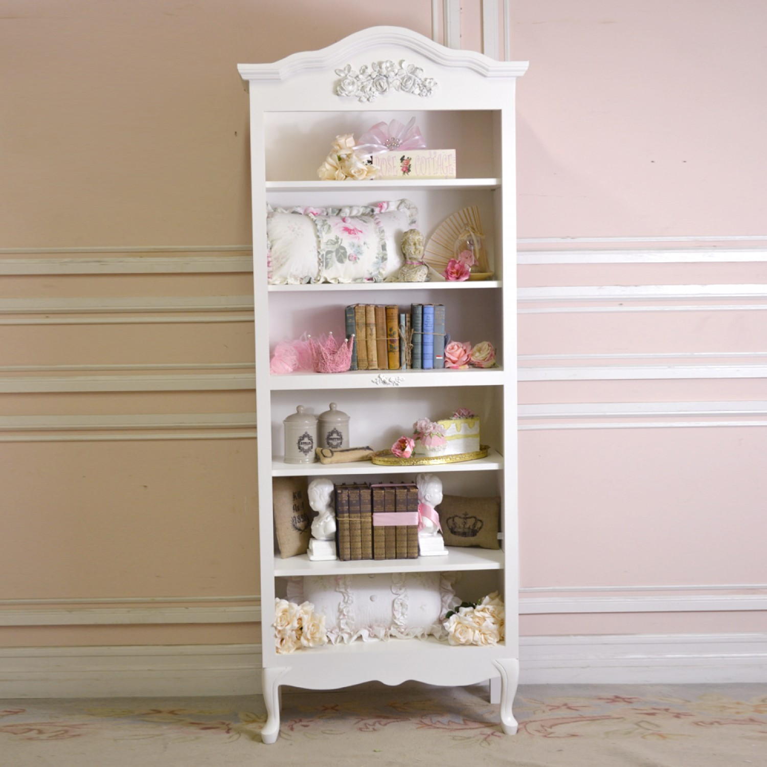 slim and lovable white shabby chic bookshelves idea with carved pattern beneath pink painted wall