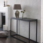 slim console table for home furniture ideas in black with wooden top and iron leg decorated with cool table lamp and glass vase plus dark hardwood flooring