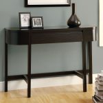 slim console table in round shape and dark finishing plus photo frame and classic vase and wooden laminate floor