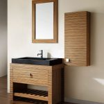 small bathroom vanities with vessel sinks in minimalist design with accented wooden pattern plus black sink and framed mirror combined with wooden flooring
