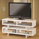 Small Modular Ikea White Tv Stand Idea With Storage And Double Legs On Wooden Floor With Creamy Painted Wall