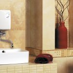 small white electric tankless water heater bathroom installation natural beige porcelaine wall faucet and sink wooden cabinet flower pot accent