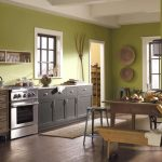 smooth green paint color for kitchen design with wall art and storage and gray cabinet and rustic wooden table beneath pendant