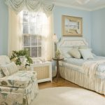 soft blue arch treatment for boring small window bedroom macthed with soft blue walls and blue leaves sofas