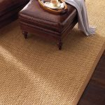 Soft Sisal Rug Decorated On Solid Wooden Floor In Living Room Ideas With Brown Leather Sofa And Ottoman Coffee Table