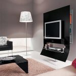 sophisticated black slim board idea for tv stand with metal pole before white floor lamp and black sofa and black coffee table and creamy rug