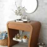 sophisticated small bathroom vanities with vessel sinks made of wooden with glass rack and silver sink plus modern faucet and greenery plus round mirror mounted on wall