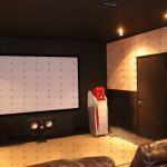 soundproofing an apartment theatre room by acoustic panels on the walls and floors