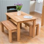 space saver dining set in oak and bench set adorned with pretty vase and flower plus solid hardwood flooring