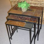 space saving stepping slate end tables with natural slate tilling plus black metal leg plus greenery as centerpiece