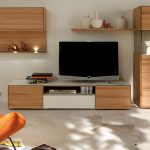 spacious room design with beige wooden idea for tv stand with rack on white floor beneath white wall