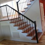 stairs handrails wood floor wall cupboard