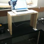 standing desk wood box table books