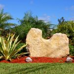 statement large landscape rocks for beautiful front garden look beautiful red mulch green plants two small stones