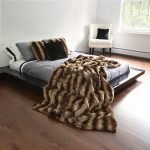 stripe brown faux sheepskin throw design in gray bedding with open plan with corner white chair with black cushions
