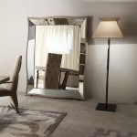 stunning and posh beveled floor mirror design aside floor lamp om area rug wih chair beneath white wall