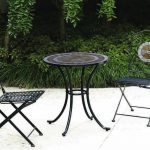 stunning black metal chairs with floral accent before round coffee table made of black metal for best patio furniture brands