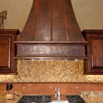 stunning kitchen ideas with wood vent hood and cool backspashes and stainless steel stove and wooden cabinets with marble countertop