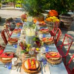 stunning outdoor thanksgiving decoration idea with dining set and red chairs and white table with centerpiece on spacious concrete patio