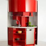 stylish red avanti compact kitchen design in round shape with sink and cooktop and gray stainless steel backsplash and storage