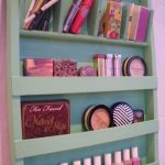 super large makeup organizing idea on wooden storage stacked on pink wall for makeup tools