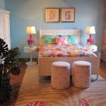 sweet lilly pulitzer furniture idea for bedding with colorful pink sheet and double tube pouf on patterned brown area rug with unique side table and brick wall and glass window