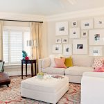 sweet picture frame target design in living room with pink wall and white sofa and evening hie pillows and white pouf coffee table and large glass window with banquette
