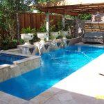 swimming pool water waterfall plants chair