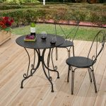 target patio chairs in  metal with round coffee table and garden plus wooden flooring