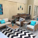 target patio chairs with wooden frame and leather plus blue cushion and wooden table plus modern pation rug