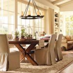 traditional centerpieces for dining room tables with greenery placed on glass jar plus wooden dining table and seating with cover plus rug and pendant chandelier
