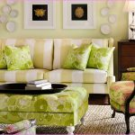 tropical living room design by lilly pulitzer furniture with otoman coffee table and creamy stripe patterned sofa and wooden console tale and white wal